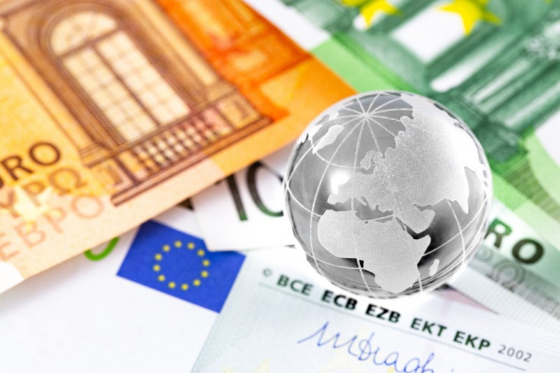 business finance concept in sphere globe and money, closeup euro banknotes